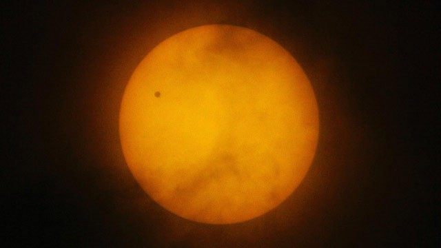 PHOTO: A tiny dot of the planet Venus is seen on the northwest side of the Sun's disc as viewed in Manila, Philippines, on a rare astronomical occasion in this June 8, 2004 file photo.