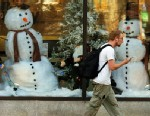 PHOTO: A man walks past a holiday window display during unseasonably warm weather at the Penn Security Bank & Trust building on Spruce Street in downtown Scranton, Pa., on Dec. 4, 2012.
