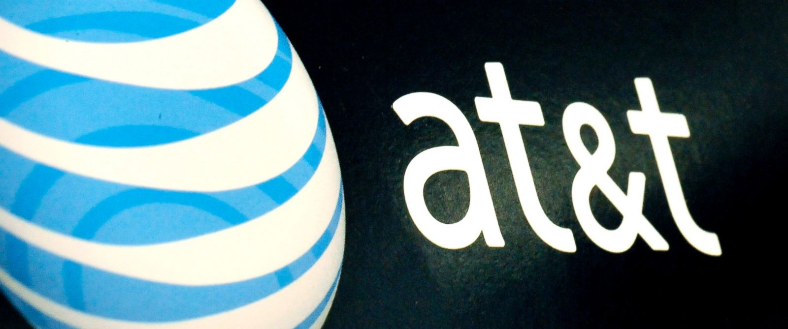 PHOTO: In this Oct. 19, 2009 file photo, the AT&T logo is on display at a RadioShack store in Gloucester, Mass. On April 21, 2014, AT&T said that it plans a major expansion of super-fast Internet services to cover as many as 100 municipalities.