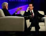 PHOTO: Former President Bill Clinton and Comedy Centrals Stephen Colbert, right, speak during the Clinton Global Initiative at Washington University, April 6, 2013, in St. Louis.