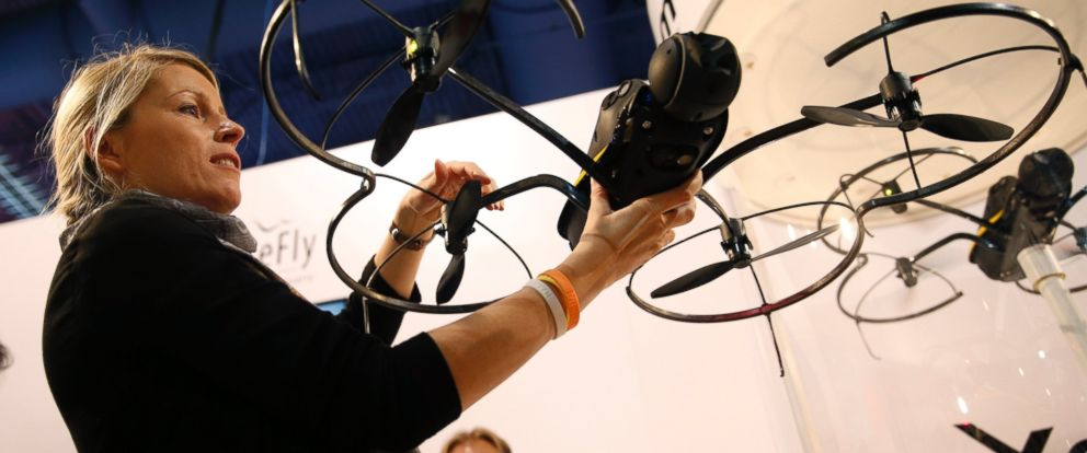 PHOTO: Andrea Halter holds up an Exom senseFly drone at the Parrot booth during CES on Jan. 6, 2015, in Las Vegas.