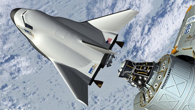 PHOTO: This artists rendering provided by Sierra Nevada Space Systems shows the companys Dream Chaser spacecraft docking with the International Space Station.