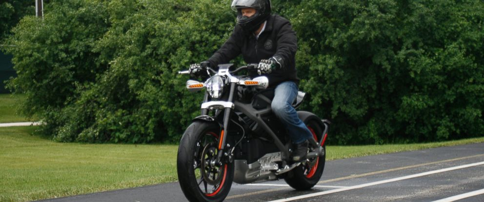 PHOTO: In this June 18, 2014 photo, employee Ben Lund demonstrates Harleys new electric motorcycle at Harleys research facility in Wauwatosa, Wis.