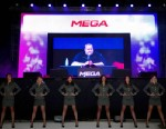 "PHOTO: Indicted Megaupload founder Kim Dotcom appears on a large screen during the launch of a new file-sharing website called ""Mega"" at his Coatesville mansion in Auckland, New Zealand, Jan. 20, 2013."