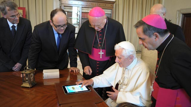 PHOTO: Pope Benedict XVI touches an iPad to send a tweet for the launch of the Vatican news information portal
