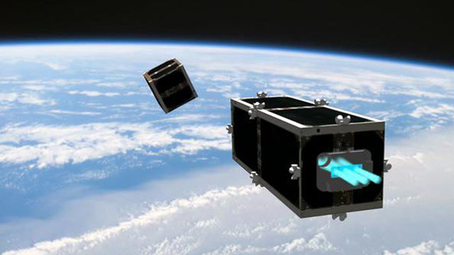 PHOTO: In this illustration provided by the Swiss Space Center of the Swiss Federal Institute of Technology (EPFL), Feb. 15, 2012, the CleanSpace One is chasing its target, one of the CubeSats launched by Switzerland in 2009.