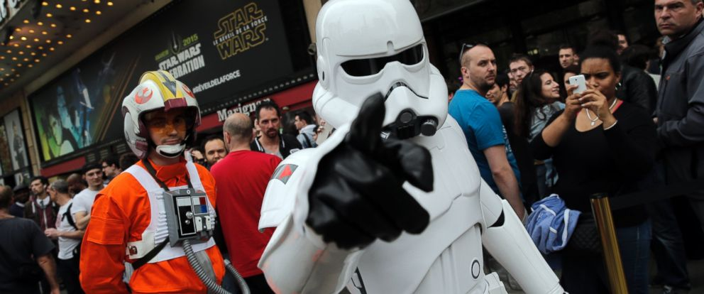 PHOTO: A man dressed as a Stormtrooper walks past people as they queue to attend the steaming of Star Wars Celebration from the Anaheim Convention Center in Calif., in Paris, France, April 16, 2015.