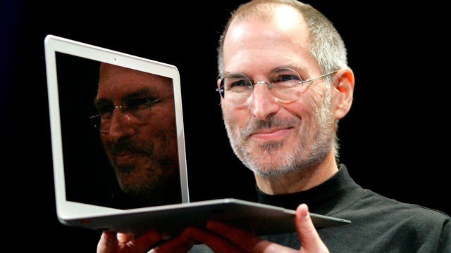 PHOTO: In this Jan. 15, 2008, file photo, Apple CEO Steve Jobs holds up the new MacBook Air after giving the keynote address at the Apple MacWorld Conference in San Francisco.