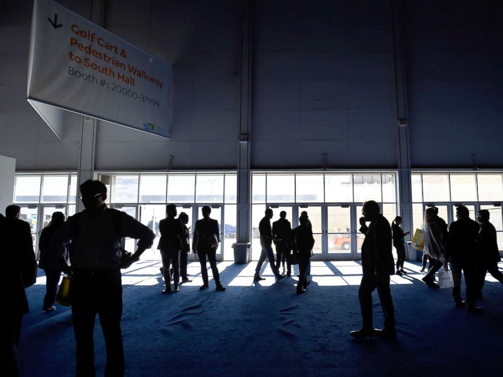 PHOTO: Attendees stand around after the power went out during CES 2018 inside the central hall at the Las Vegas Convention Center, Jan. 10, 2018, in Las Vegas.