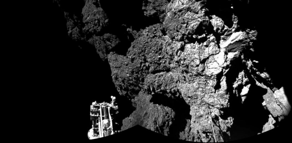 PHOTO: This handout photo provided by the European Space Agency shows the surface of the 67P/Churyumov-Gerasimenko comet as seen from the Philae lander, which landed on the comets surface on November 12, 2014.
