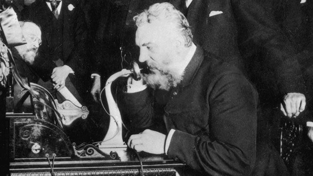 PHOTO: Alexander Graham Bell makes the first telephone call from New York to Chicago in 1892.
