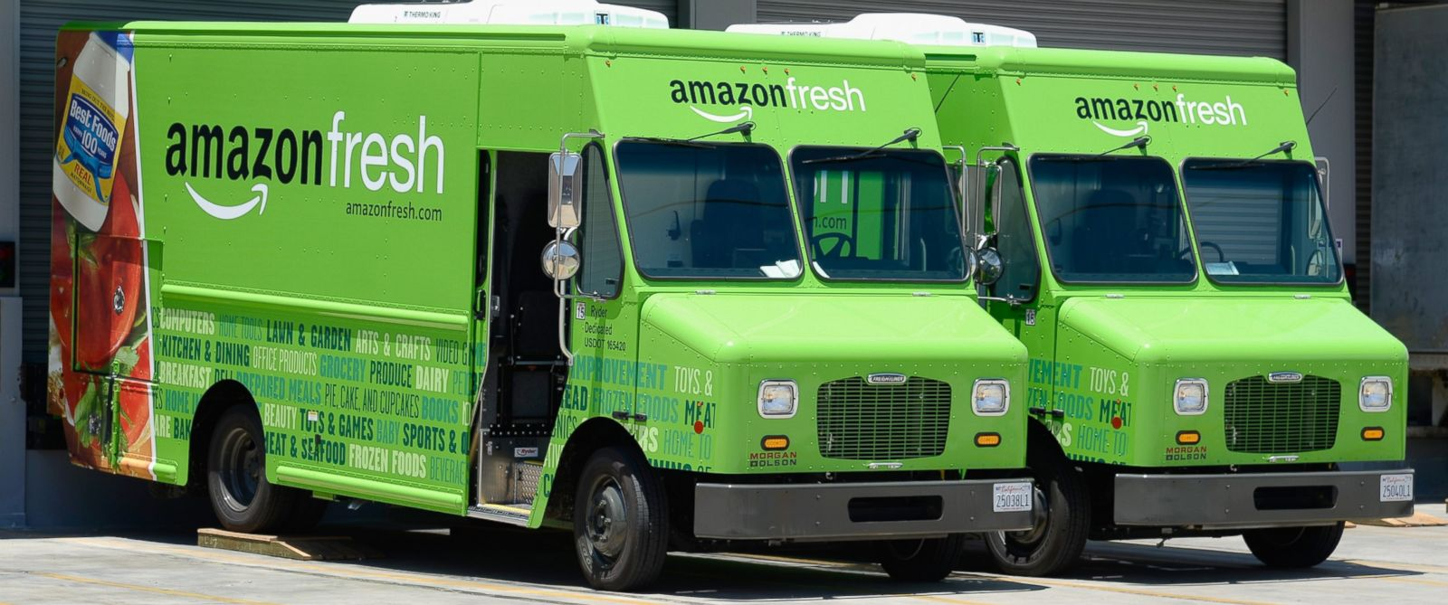 PHOTO: Amazon Fresh trucks sit parked at a warehouse in Inglewood, Calif., June 27, 2013.