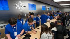PHOTO: Employees assist customers at the Fifth Avenue Apple Store in New York, Sept. 20, 2013.