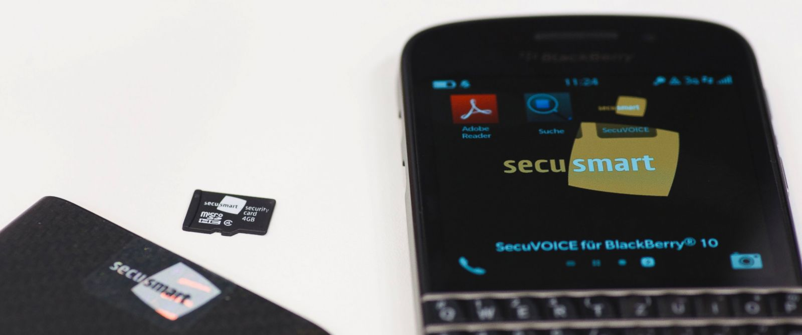 PHOTO: A Secusmart security card, center, sits with a BlackBerry 10 mobile device in this arranged photograph on day three of the Mobile World Congress in Barcelona, Spain, Feb. 26, 2014.