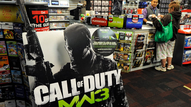 "PHOTO: A cardboard display advertises the highly anticipated video game, ""Call Of Duty: Modern Warfare 3"" at a GameStop Corp. store."