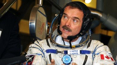 PHOTO: Canadian astronaut Chris Hadfield, speaks with a journalist during his pre-flight preparation at the Cosmonaut Training Centre in Star City, outside Moscow, on Nov.  28, 2012.