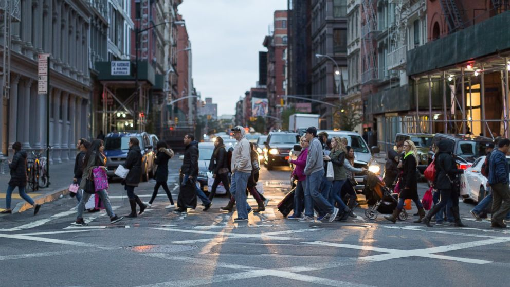 PHOTO: Cars stop at a crowded street crossing.