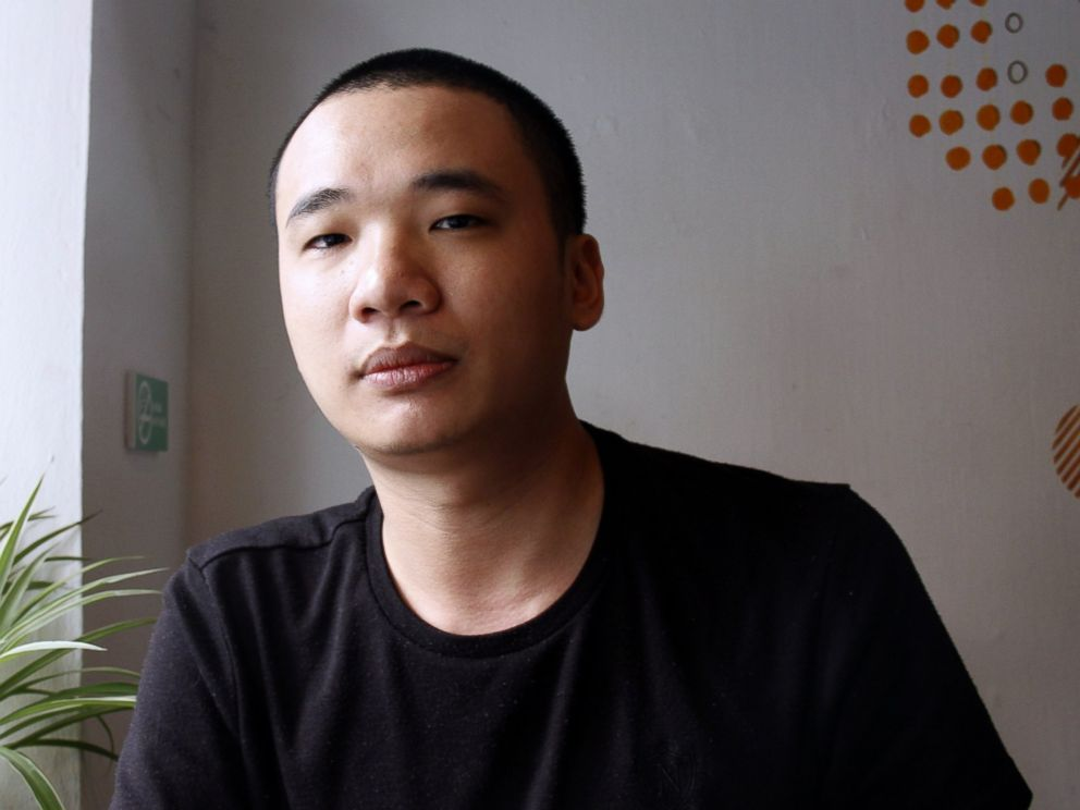 PHOTO: This picture taken on Feb. 5, 2014 shows Nguyen Ha Dong, the author of the game Flappy Bird relaxing inside a coffee shop in Hanoi.