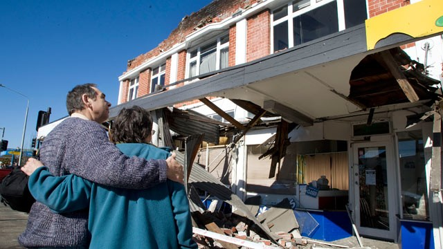 PHOTO: People look at damaged buildings after a 7.1 magnitude earthquake struck 30km west of the city on the morning of Sept. 4, 2010 in Christchurch, New Zealand.