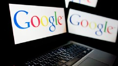 PHOTO: Google logo on computer screens