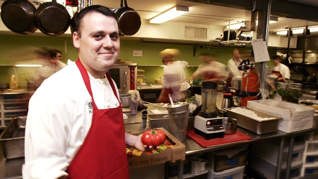PHOTO: Chef Homaro Cantu holds a tomato in the kitchen of his new restaurant called &quot;Moto&quot; in Chicago, Illinois, May, 15, 2007.