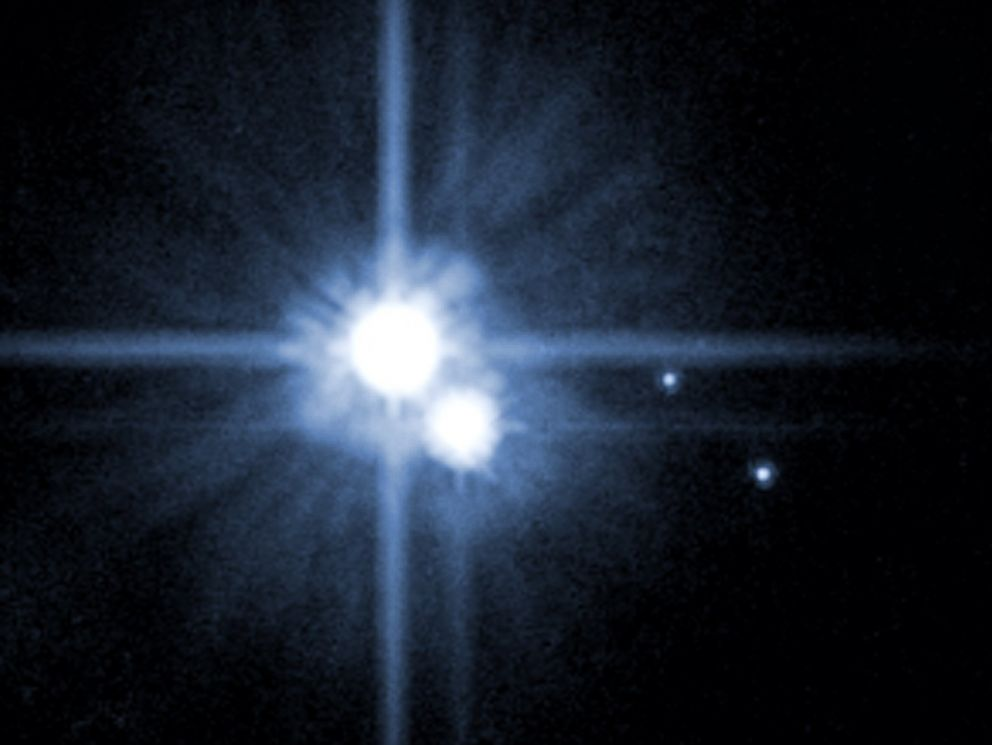 PHOTO: A Hubble Space Telescope image released by NASA in 2006 shows Pluto and three of its five moons.