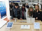 PHOTO: In this file photo, shoppers gather around a display for the Apple ipad mini inside of a Best Buy store during their Black Friday sale which started at midnight on November 23, 2012 in Rockville, Maryland.