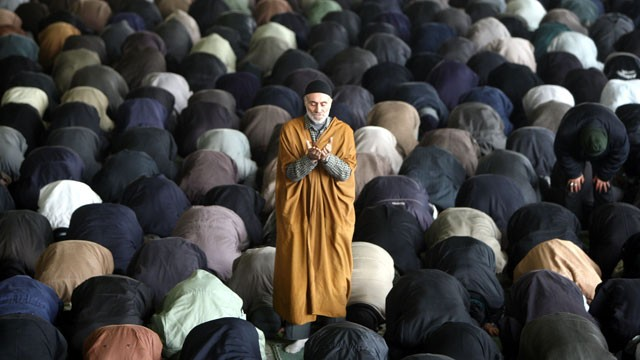 PHOTO: Iranian men perform the weekly Friday prayer at Tehran University.