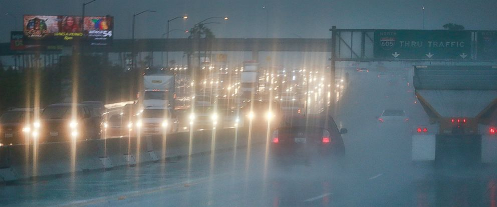 PHOTO: Heavy rain slows down motorists commuting on the 605 Freeway in Whittier, Calif. on March 7, 2016.