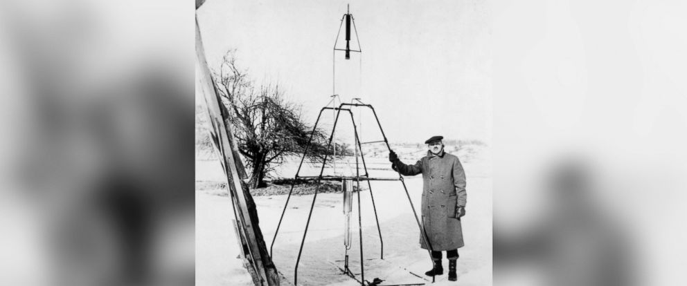 PHOTO: American physicist Dr. Robert Hutchings Goddard stands next to the first liquid-propelled rocket prior to its launch in Auburn, Massachusetts on March 16, 1926.