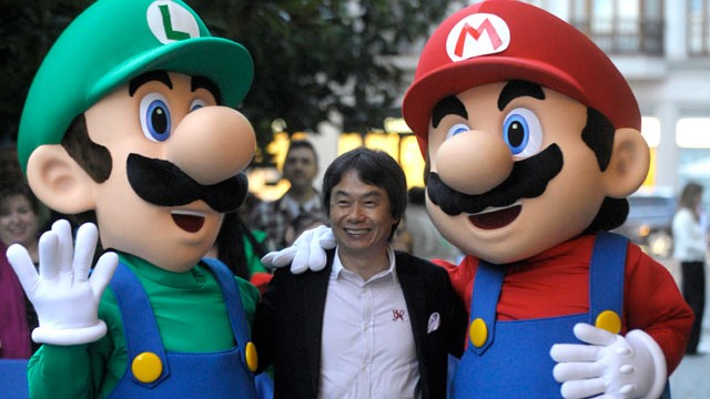PHOTO: Game designer Shigeru Miyamoto of Nintendo discusses sharing culture in gameplay. Miyamoto, center, poses with game stars Mario Bros and Luigi, Oct. 25, 2012.