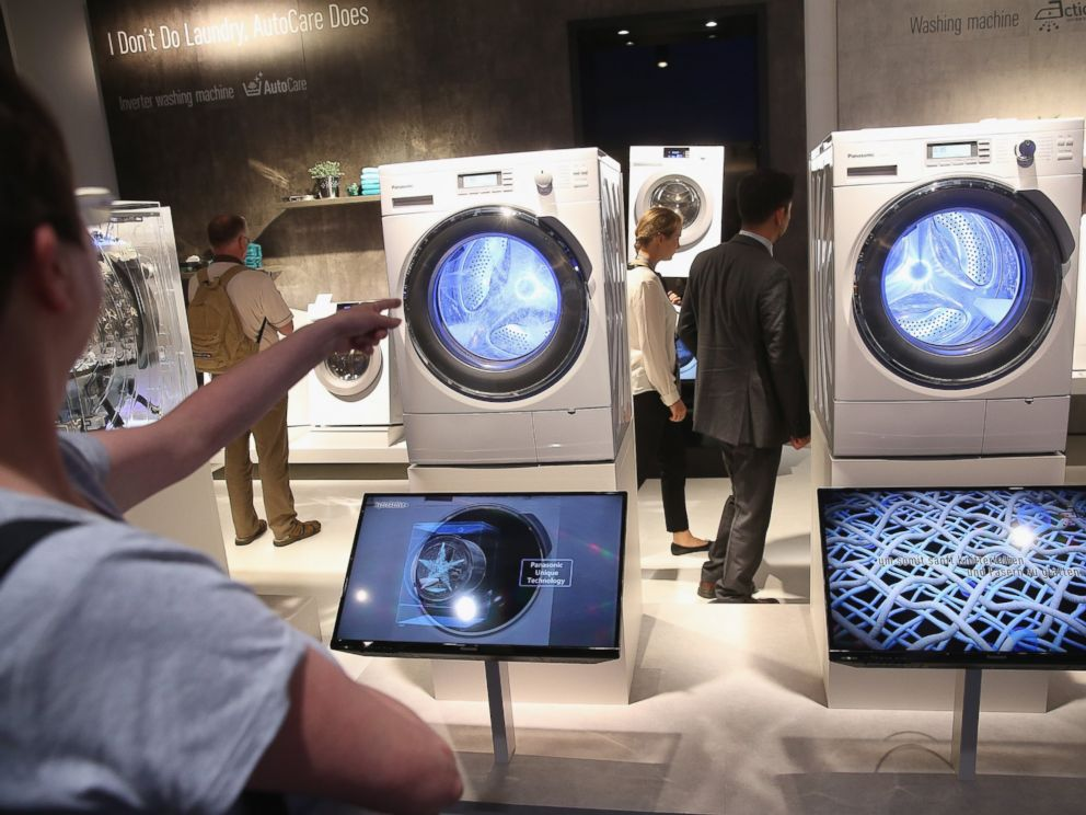 PHOTO: Visitors look at the latest generation of smart technology washing machines at the Panasonic stand at the 2014 IFA home electronics and appliances trade fair in Berlin, Sept. 5, 2014.