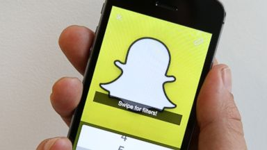 PHOTO: The Snapchat app is demonstrated for this photo illustration in London, England on Oct. 6, 2014.