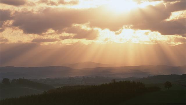 PHOTO: Sunlight shines through clouds
