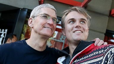 PHOTO: Apple CEO Tim Cook takes a photo with a man waiting in line to buy the new iPhone 6 at an Apple Store on September 19, 2014 in Palo Alto, Calif.