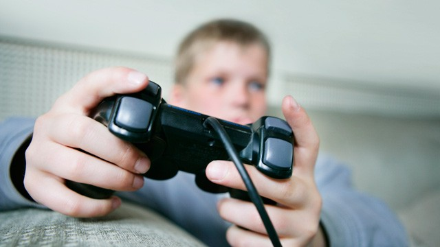 PHOTO: Boy playing video game