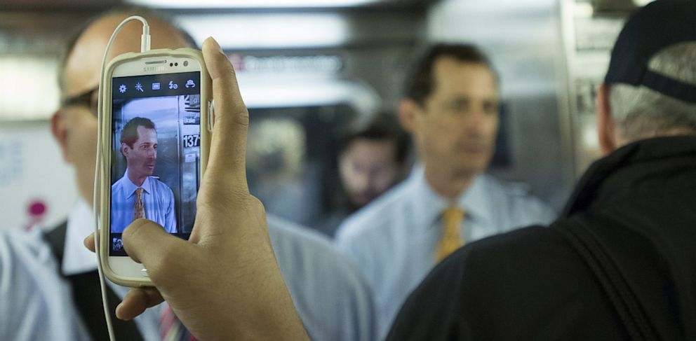 PHOTO: A passenger takes a cell phone photo of mayoral hopeful Anthony Weiner on a subway train