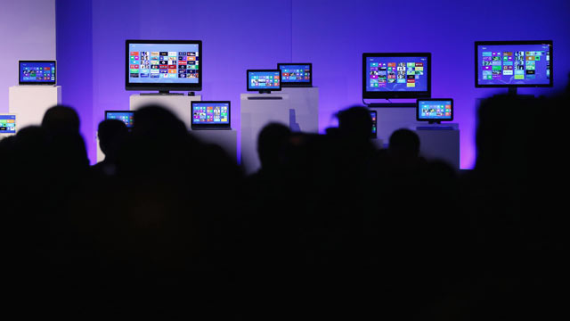 PHOTO: People sit in front of devices running the Microsoft Windows 8 operating system at a press conference launch of the system, Oct. 25, 2012, in New York City.