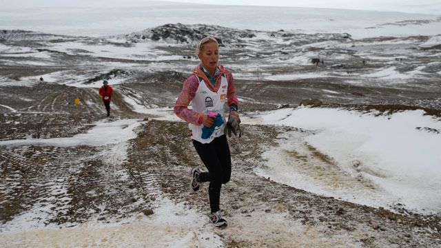 PHOTO: Winter Vinecki running along the Antarctica Marathon course on King George Island. Icy conditions made this one of the toughest marathons many runners have encountered.