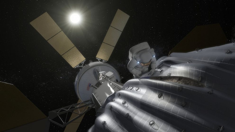 PHOTO: Astronaut taking samples from asteroid