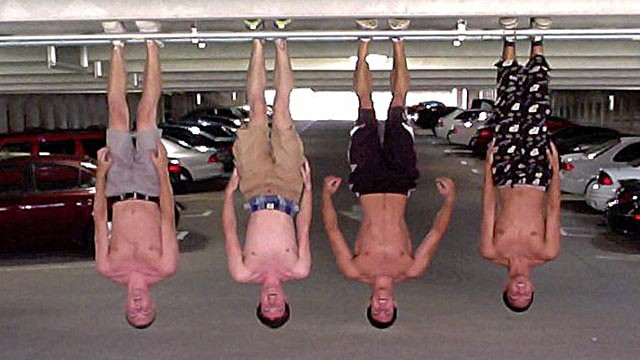 "PHOTO: A group of Purdue University students call themselves the Batman Boilers and are pictured here in a parking garage showing off their new trend, ""Batmanning."""