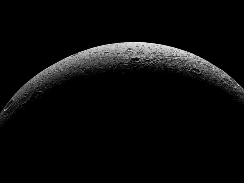 PHOTO: NASAs Cassini spacecraft captured this parting view showing the rough and icy crescent of Saturns moon Dione following the spacecrafts last close flyby of the moon on Aug. 17, 2015.