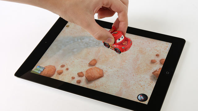 PHOTO: Let your kids drive a car on your iPad? Really? That?s the basic idea behind Disney?s new Appmates; iPad-friendly toys that basically turn your tablet into a virtual play mat.