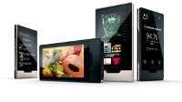"PHOTO Microsoft is back with the Zune HD, a slim flash memory device with a tapered, brushed aluminum back and a touchscreen that can respond to multi-finger gestures such as ""pinching"" to zoom out of a photo."