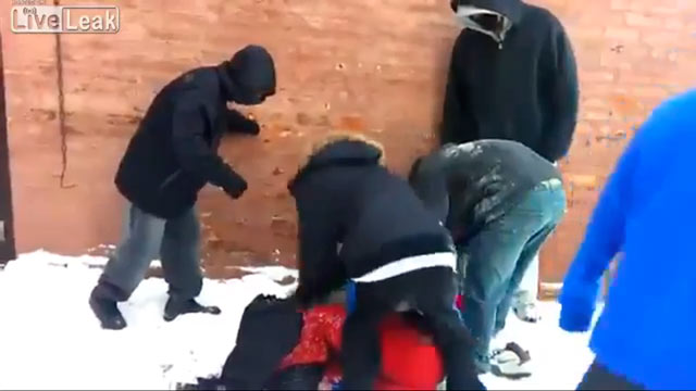 PHOTO: In a clip posted on YouTube, six attackers are seen brutally beating and robbing a teenager in an alley in Chicago, IL.