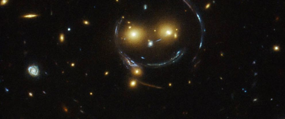"PHOTO: In the center of this image is the galaxy cluster SDSS J1038+4849, which appears to be ""smiling."""