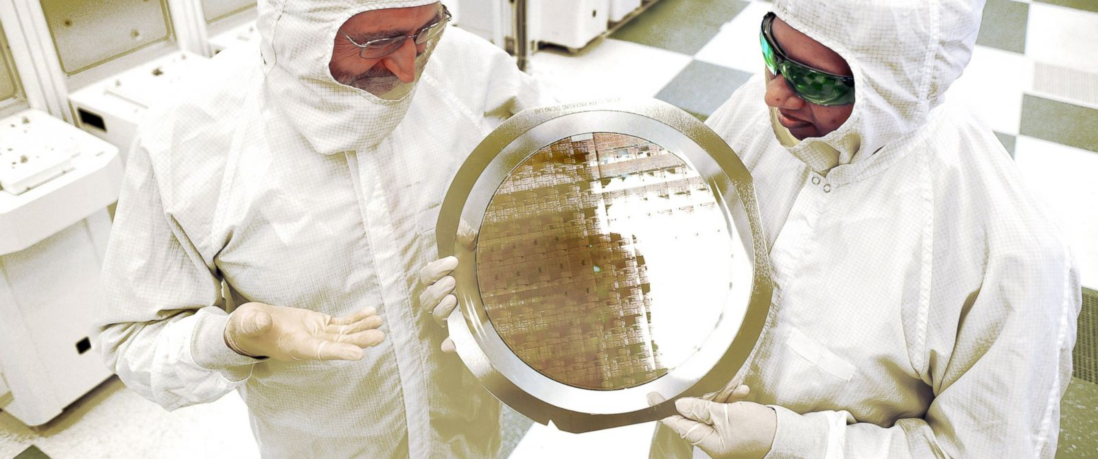 PHOTO: SUNY College of Nanoscale Science and Engineerings Michael Liehr, left, and IBMs Bala Haranand look at wafer comprised of 7nm chips on Thursday, July 2, 2015, in a NFX clean room Albany.