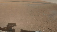 PHOTO: The first color panorama from the Mars rover Curiosity shows a desert plain in the foreground, and the rim of a crater on the horizon.
