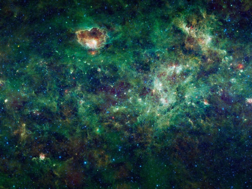 PHOTO: This enormous mosaic of the Milky Way galaxy from NASAs Wide-field Infrared Survey Explorer, or WISE, shows dozens of dense clouds, called nebulae.