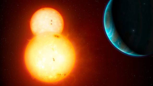 PHOTO: The NASA Kepler probe has found two new solar systems that have double stars and at least one planet each. One is seen in this artists conception.